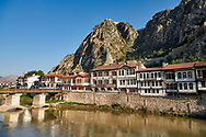 Ottoman villas of Amasya along the banks of the river Yesilırmak k, below the Pontic Royal rock tombs and mountain top ancient citadel, Turkey .<br /> <br /> If you prefer to buy from our ALAMY PHOTO LIBRARY  Collection visit : https://www.alamy.com/portfolio/paul-williams-funkystock/amasya-turkey.html<br /> <br /> Visit our TURKEY PHOTO COLLECTIONS for more photos to download or buy as wall art prints https://funkystock.photoshelter.com/gallery-collection/3f-Pictures-of-Turkey-Turkey-Photos-Images-Fotos/C0000U.hJWkZxAbg