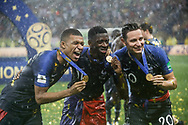 Kylian Mbappe, Ousmane Dembele and Florian Thauvin of France celebrate after winning the 2018 FIFA World Cup Russia, final football match between France and Croatia on July 15, 2018 at Luzhniki Stadium in Moscow, Russia - Photo Thiago Bernardes / FramePhoto / ProSportsImages / DPPI