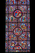 Medieval stained glass Window of the Gothic Cathedral of Chartres, France - dedicated to The life of St Lubin. . A UNESCO World Heritage Site.