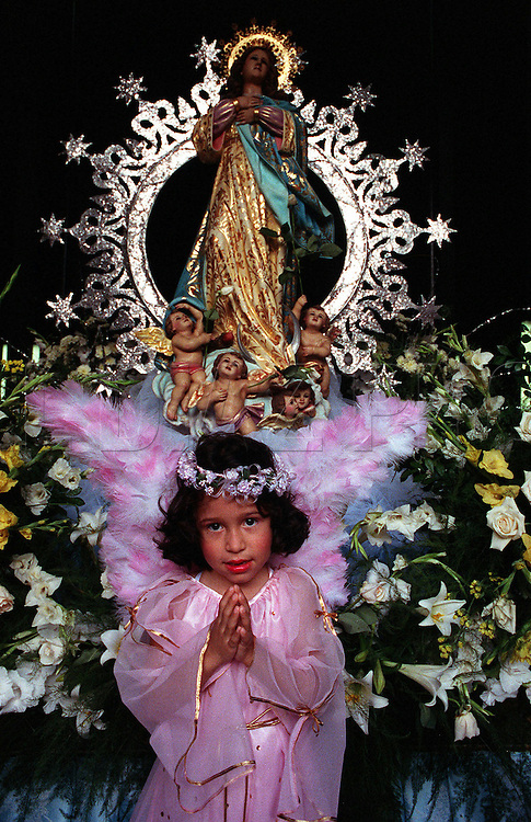 Dressed as an angel, Arian Marisel Rodriquez, 6, celebrates first communion for boys and girls at La Merced Catholic Church in Panama City, Panama.