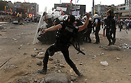 A Turkish riot policeman throws a tear gas during clashes at Taksim Square in Istanbul, Turkey, 11 June 2013. <br /> Turkish police began an operation near Istanbul's Taksim Square early 11 June. It was not immediately clear whether they were planning to clear the square of barricades erected by protesters around the square. Demonstrators say they oppose Turkish Prime Minister Recep Tayyip Erdogan's increasingly authoritarian leadership style and efforts to introduce more restrictive laws, such as ones regulating alcohol consumption.
