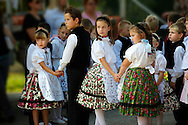 traditional children dancers in local german Svab traditional  dress - Annual wine harvest festival ( szuret fesztival ) . Hajos ( Hajós); Hungary .<br /> <br /> Visit our HUNGARY HISTORIC PLACES PHOTO COLLECTIONS for more photos to download or buy as wall art prints https://funkystock.photoshelter.com/gallery-collection/Pictures-Images-of-Hungary-Photos-of-Hungarian-Historic-Landmark-Sites/C0000Te8AnPgxjRg