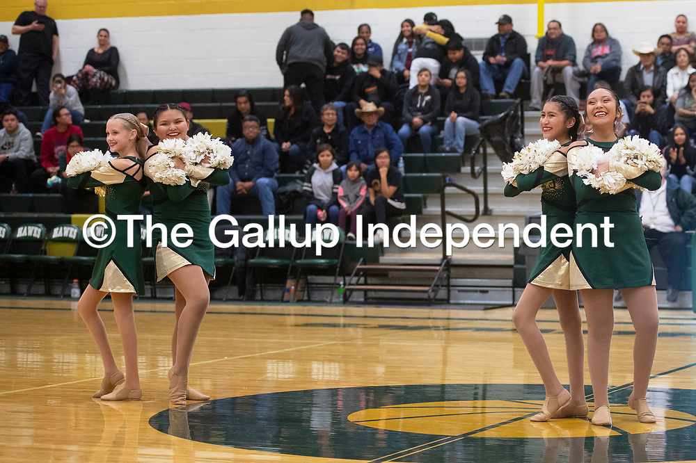 The Thoreau Hawkettes dance team perform during halftime Tuesday night at the Thoreau and Rehoboth varsity boys basketball game in Thoreau.
