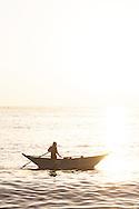 Fisherman at sunset, Sri Lanka..NOT FOR COMMERCIAL USE UNLESS PRIOR AGREED WITH PHOTOGRAPHER. (Contact Christina Sjogren at email address : cs@christinasjogren.com )