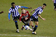 Middlesbrough forward Duncan Watmore (18) is fouled by Cheyenne Dunkley of Sheffield Wednesday and Joey Pelupessy of Sheffield Wednesday  during the EFL Sky Bet Championship match between Sheffield Wednesday and Middlesbrough at Hillsborough, Sheffield, England on 29 December 2020.