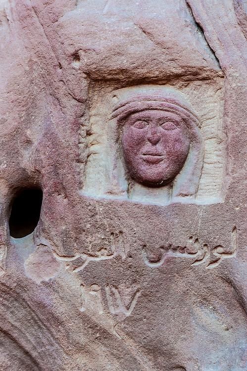 Carving of Lawrence of Arabia carved into a rock in the Arabian Desert at Wadi Rum, Jordan.