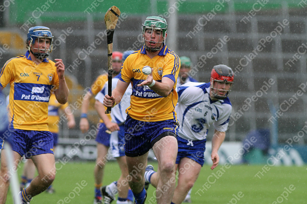 Clare's Cathal Chaplin about to get his clearance away against Waterford in the Munster Intermediate Hurling Semi-Final. - Photograph by Flann Howard