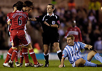 Photo: Jed Wee.<br /> Middlesbrough v Coventry City. The FA Cup. 08/02/2006.<br /> <br /> Middlesbrough's Emanuel Pogatetz (L) has to be held back by his team mates and referee Mark Atkinson after a foul on him by Coventry's James Scowcroft.