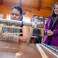042815       Cable Hoover<br /> <br /> Navajo culture instructor Bonnie Yazzie right, watches over the shoulder of Kay Mariano during a weaving class at Navajo Technical University in Crownpoint Tuesday.