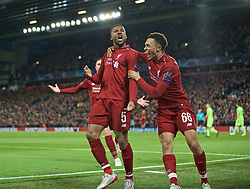 BRITAIN-LIVERPOOL-FOOTBALL-UEFA CHAMPIONS LEAGUE-LIVERPOOL VS FC BARCELONA..(190507) -- LIVERPOOL, May 7, 2019  Liverpool's Georginio Wijnaldum (C) celebrates scoring during the UEFA Champions League Semi-Final second Leg match between Liverpool FC and FC Barcelona at Anfield in Liverpool, Britain on May 7, 2019. Liverpool won 4-3 on aggregate and reached the final. FOR EDITORIAL USE ONLY. NOT FOR SALE FOR MARKETING OR ADVERTISING CAMPAIGNS. NO USE WITH UNAUTHORIZED AUDIO, VIDEO, DATA, FIXTURE LISTS, CLUBLEAGUE LOGOS OR ''LIVE'' SERVICES. ONLINE IN-MATCH USE LIMITED TO 45 IMAGES, NO VIDEO EMULATION. NO USE IN BETTING, GAMES OR SINGLE CLUBLEAGUEPLAYER PUBLICATIONS. (Credit Image: © Xinhua via ZUMA Wire)