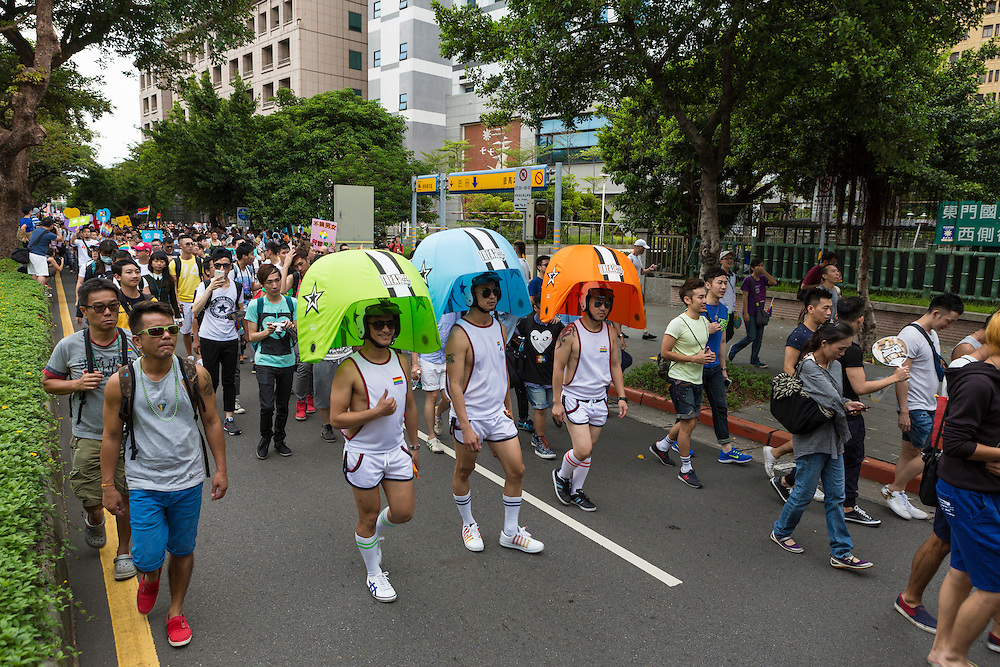 Some marchers wore creative costumes, others regular clothes in the annual gay pride march through the city.