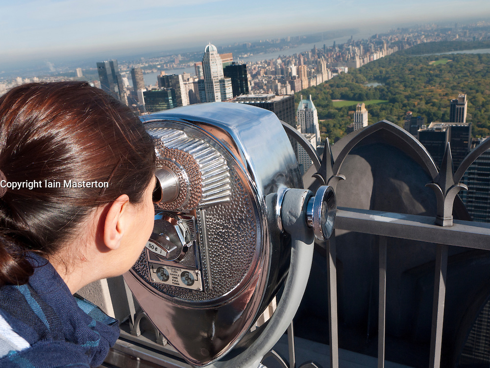 Public pay viewing coin operated binoculars on Top of The Rock observation platform  at Rockefeller Center in Manhattan New York city