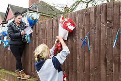 Two women claiming to be Gypseys arrive in South Park Crescent, Hither Green, opposite the home of pensioner Richard Osborn-Brooks to re-tie floral tributes to burglar Henry Vincent who was killed in a struggle with Osborn-Brooks, after they were torn down from the fence by a man thought to be a local resident. London, April 10 2018.