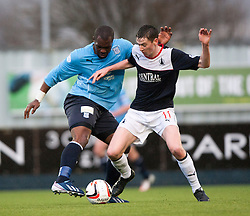 Dundee's Christian Nade and Falkirk's Conor McGrandles.<br /> Falkirk 2 v 0 Dundee, Scottish Championship game at The Falkirk Stadium.<br /> © Michael Schofield.