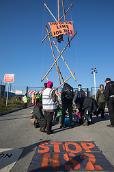 West Hyde, UK. 9th September, 2020. Anti-HS2 activists use a tripod to block one of several entrances to the Chiltern Tunnel South Portal site for the HS2 high-speed rail link for the entire day. The protest action, at the site from which HS2 Ltd intends to drill a 10-mile tunnel through the Chilterns, was intended to remind Prime Minister Boris Johnson that he committed to remove deforestation from supply chains and to provide legal protection for 30% of UK land for biodiversity by 2030 at the first UN Summit on Biodiversity on 30th September.