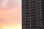 Social housing high rise tower block as the sun sets in Highgate on 14th December 2020 in Birmingham, United Kingdom. Following the Big City Plan of February 2008, Highgate is now a district of Birmingham City Centre, yet is a very poor area of housing estates, lacking in investment.