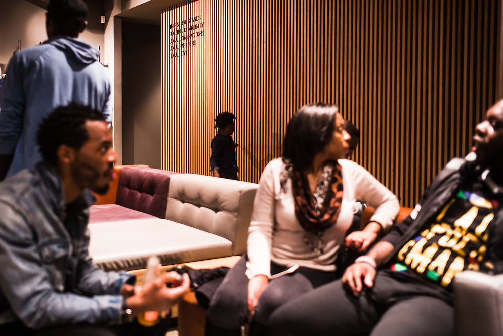 """BIRMINGHAM, AL –OCTOBER 17, 2018: Artists, activists and community members mingle at the new Starbucks Community Store in Birmingham's West End. As one of the first """"Community Stores"""" in the United States, the new storefront is intended to create pathways of opportunity for young people through training programs and other events that encourage community growth."""