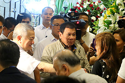 "October 2, 2016 - Philippines - Jun Santiago (husband of Sen. Santiago,left) assisted President Rodrigo Duterte (center) while talking Ilocos Norte Governor Maria Imelda Josefa  ""Imee"" Romualdez Marcos (right) during the wake of Sen. Miriam Defensor Santiago at Immaculate Conception Cathedral in Quezon City. Sen. Santiago pass-away last September 29, 2016 due to her stage 4 lung cancer and she is one of the candidates for presidential election 2016. (Credit Image: © Gregorio B.Dantes Jr/Pacific Press via ZUMA Wire)"