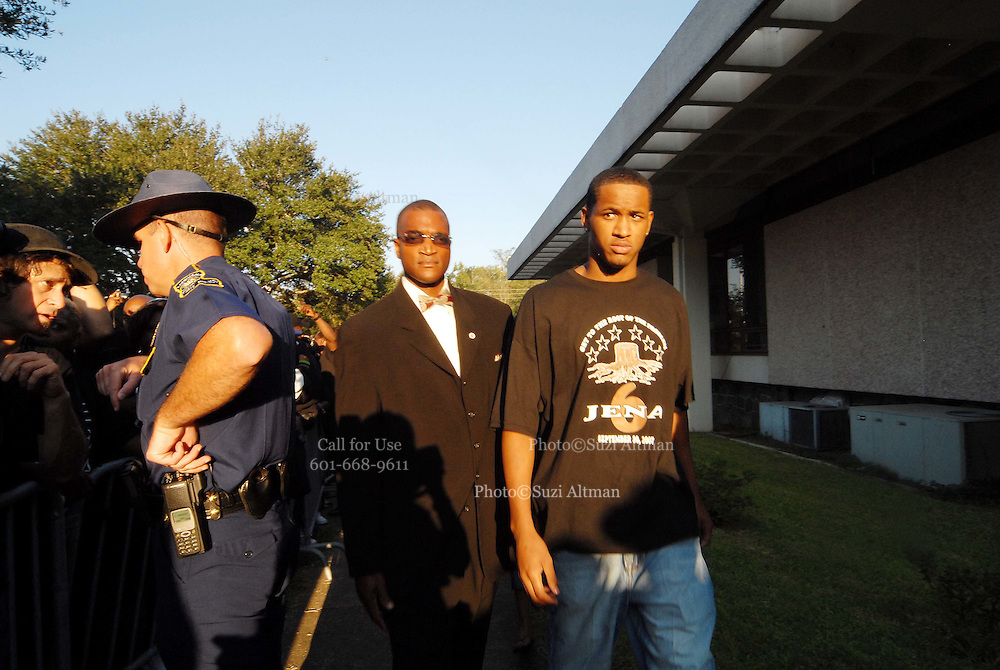 Bryant Purvis, 17 and one of the so-called Jena 6, right, walks outside the LaSalle Parish Courthouse during a rally with Reverend Al Sharpton and others in Jena, Louisiana, on Thursday, Sept. 20, 2007. Thousands of people gathered to support the black teenagers who had been charged with attempted murder in the beating of a white classmate.)photo/Suzi Altman)