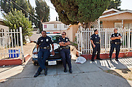 """LAPD watching outside the services.<br /> Funeral services for Kevin """"Flipside"""" White at Macedonia Church in Watts.<br /> White was shot dead in what is believed to be an unprovoked attack during a gang conflict at Watts' Nickerson Gardens and Jordan Downs housing projects.<br /> Flipside, 44, was a founding member of Watts' first major label hip hop act, O.F.T.B. (Operation From The Bottom)."""