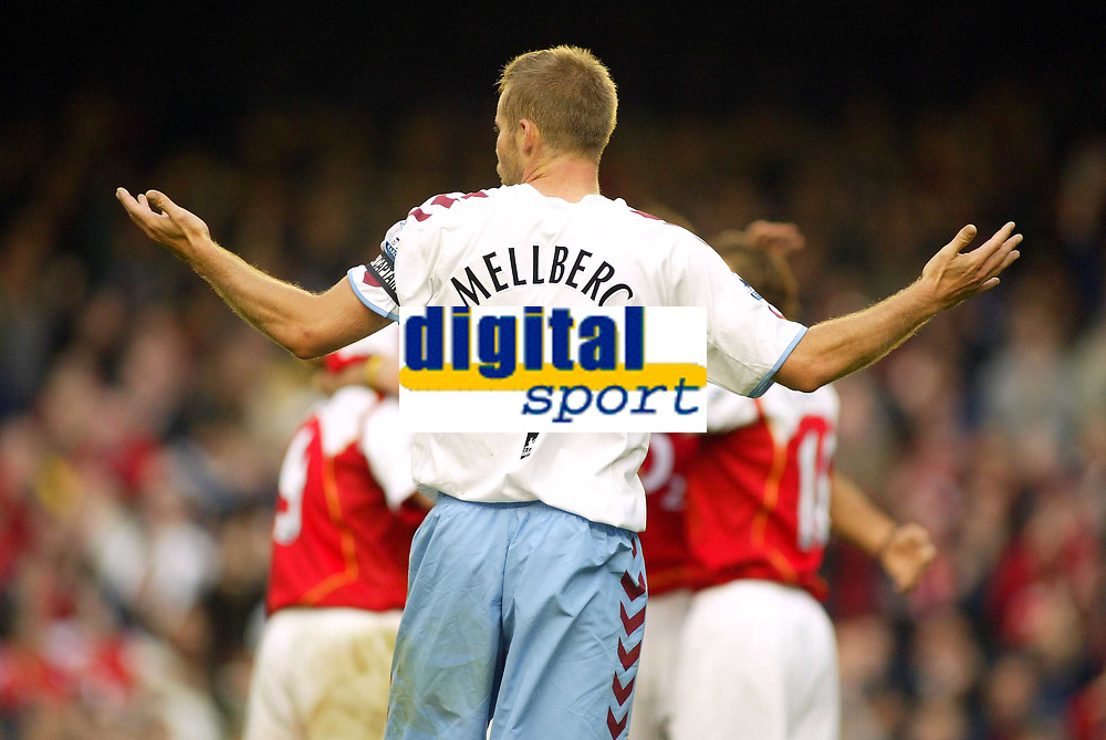 16/10/2004<br />FA Barclays Premiership - Arsenal v Aston Villa - HIghbury<br />As the Arsenal players celebrate in the background after their 3rd goal of the afternoon, Aston Villa's Olof Mellberg shrugs his shoulders as to how they managed to get through the defence so easily.<br />Photo:Jed Leicester/BPI (back page images)