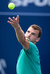 August 9, 2018 - Toronto, ON, U.S. - TORONTO, ON - AUGUST 09: Grigor Dimitrov (BUL) serves the ball during his third round match of the Rogers Cup tennis tournament on August 9, 2018, at Aviva Centre in Toronto, ON, Canada. (Photograph by Julian Avram/Icon Sportswire) (Credit Image: © Julian Avram/Icon SMI via ZUMA Press)