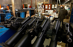 HERSTAL, BELGIUM - JUNE-13-2003 - Orders from military, defense and police departments from around the world are processed in an office surrounded by automatic weapons at the FN Herstal weapons fabrication plant near Liege, Belgium. (PHOTO © JOCK FISTICK)