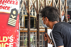 A boy buying liquor from a shop in Kolkata, India on May 5, 2020. Goverment ordered to open liquor shop amidst 14 days of extended lockdown in India. Guidelines were put forth and social distancing protocols were ordered to be followed at any cost during working hour of the liquor shop in the country. Photo by Debarchan Chatterjee/ABACAPRESS.COM