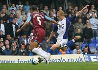 Photo: Steve Bond.<br />Birmingham City v West Ham United. The FA Barclays Premiership. 18/08/2007. Mikael Forssell crosses as Anton Ferdinand (5) closes