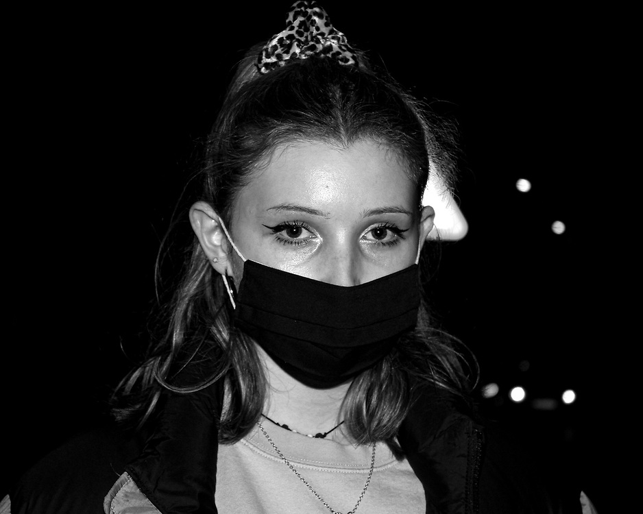 Grace Neve, a student at the University of Gloucestershire, returns from a trip to the supermarket wearing her mask to help protect against COVID-19.