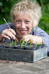 Carol Klein potting up Agapanthus campanulatus
