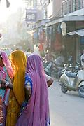Women in saris at a busy street scene in Jodhpur, Rajasthan, India