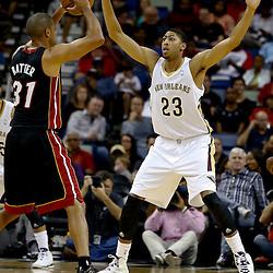 Oct 23, 2013; New Orleans, LA, USA; New Orleans Pelicans power forward Anthony Davis (23) guards Miami Heat small forward Shane Battier (31) during the first half of a preseason game at New Orleans Arena. Mandatory Credit: Derick E. Hingle-USA TODAY Sports