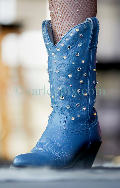 03 May 2015. New Orleans, Louisiana.<br /> The New Orleans Jazz and Heritage Festival. <br /> Kacey Musgraves wears light up cowboy boots on the Fais Do-Do stage.<br /> Photo; Charlie Varley/varleypix.com
