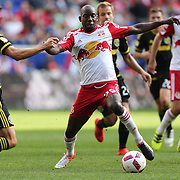 HARRISON, NEW JERSEY- OCTOBER 16:  Bradley Wright-Phillips #99 of New York Red Bulls is challenged by Michael Parkhurst #4 of Columbus Crew in action during the New York Red Bulls Vs Columbus Crew SC MLS regular season match at Red Bull Arena, on October 16, 2016 in Harrison, New Jersey. (Photo by Tim Clayton/Corbis via Getty Images)