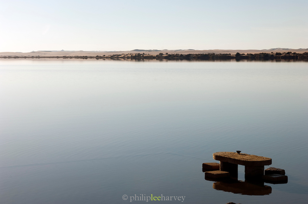 A table sitting in water at a hotel in the Siwa Oasis, Egypt