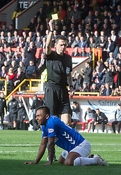 Rangers Alfredo Morelos is booked for diving by Kevin Clancy during the William Hill Scottish Cup quarter final match at Pittodrie Stadium, Aberdeen.