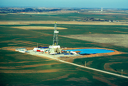 Stock photo of an aerial view of an on-shore rig and work site