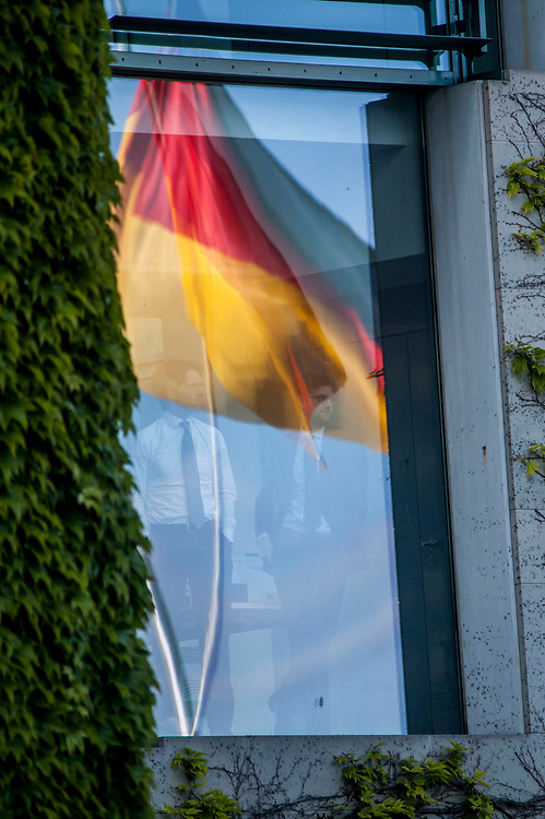 Staff memmbers are watching from a window prior to a meeting of The German Chancellor Angela Merkel , and the French President Emmanuel Macron at the chancellery in Berlin, as part of Macron first official visit as President to Germany, on  Monday, May 15, 2017. (Photo by Omer Messinger)