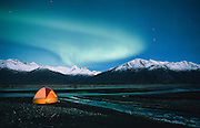 Alaska. Palmer. Tent camping under the aurora borealis or northern lights in the Mat - Su Valley.
