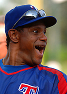 Texas Rangers' Sammy Sosa has a laugh while taking batting practice before their baseball game against the Tampa Bay Devil Rays at Walt Disney World's Wide World of Sports in Lake Buena Vista, Florida.