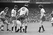 Four Dublin players surround a Dublin player who is holding the ball during the All Ireland Senior Gaelic Football Championship Final Dublin V Galway at Croke Park on the 22nd September 1974. Dublin 0-14 Galway 1-06.
