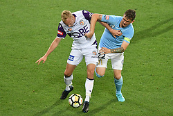 November 24, 2017 - Melbourne, Victoria, Australia - MITCH NICHOLS (6) of the Glory and MICHAEL JAKOBSEN (22) of Melbourne City fight for the ball in the round eight match of the A-League between Melbourne City and Perth Glory at AAMI Park, Melbourne, Australia. Perth won 3-1 (Credit Image: © Sydney Low via ZUMA Wire)