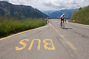 A lone rider nears the top of the Jaufenpass, the highest point at 2,094 metres on the road between Meran-merano and Sterzing-Vipiteno in South Tyrol, Italy. Struggling up to the pass's summit, the rider gives a thumbs up as he passes the lettering for a bus stop at the side of the road. South Tyrol has a surface area of 7,400sq km, roughly the same as the Black Forest and is the largest province in Italy with 60% of this is 1,600 metres above sea level. The Jaufenpass (Italian: Passo di Monte Giovo) (alt 2094m.) is a high mountain pass in the Alps in the South Tyrol in Italy. It connects Meran and Sterzing on the road to the Brenner Pass. It is the northernmost pass in the Alps that is completely in Italy. The pass road is very winding, with many switchbacks.
