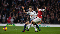 Football - 2018 / 2019 Premier League - Arsenal vs. Tottenham Hotspur<br /> <br /> Ben Davies (Tottenham FC)  clatters into Hector Bellerin (Arsenal FC) after the ball has been passed at The Emirates.<br /> <br /> COLORSPORT/DANIEL BEARHAM