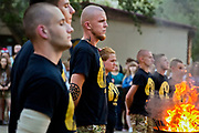 Instructors at the ultra-nationalistic Azovets children's camp are carrying out a fire ceremony to celebrate the official opening of the new location, on the banks of the Dnieper river in Kiev, Ukraine's capital.