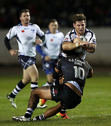 Scotland's Ben Kavanagh is tackled by New Zealand's Adam Blair during the 4 Nations match at the Zebra Claims Stadium, Workington.