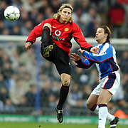 Blackburn Rovers' Tugay and Manchester United's Diego Forlan