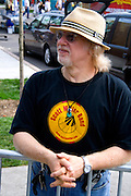 Man age 50 with straw hat totally enjoying the music of the Scott Miller Band. Grand Old Day Street Fair St Paul Minnesota USA