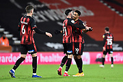 Junior Stanislas (19) of AFC Bournemouth celebrates the 2-0 win with Diego Rico (21) of AFC Bournemouth at full time during the EFL Sky Bet Championship match between Bournemouth and Nottingham Forest at the Vitality Stadium, Bournemouth, England on 24 November 2020.